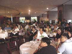 Filipino businessmen and individuals watch a presentation of GK at Aija Restaurant in downtown Dallas.